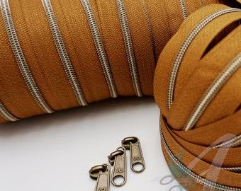 1 m endless zipper incl. 3 zippers - narrow metallized caramel - old brass