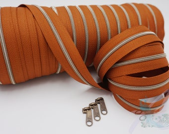 1 m endless zipper incl. 3 zippers - narrow metallized cognac - old brass