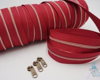 1 m endless zipper incl. 3 zippers - narrow metallized bordeaux - old brass