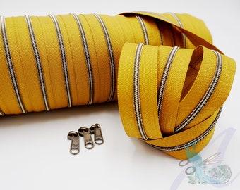 1 m endless zipper incl. 3 zippers - narrow metallized mustard - old brass (with seam thread)
