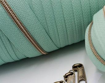 1 m endless zipper incl. 3 zippers - narrow metallized mint green - old brass