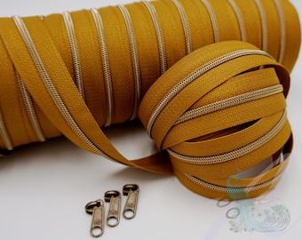 1 m endless zipper incl. 3 zippers - narrow metallized mustard - old brass