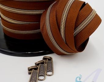 1 m endless zipper incl. 3 zippers - wide metallized bourbon old brass
