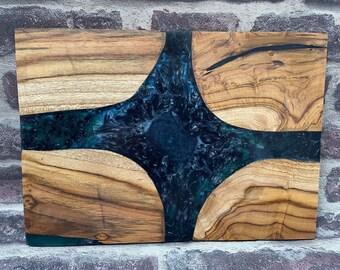 Presentation board and cut in Teck resin black epoxy/purple blue green