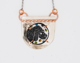 Sgraffito dog necklace. Hand-painted vitreous enamel on copper, set in copper