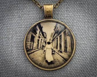 Figurative Photo Art Necklace, Woman Walking on the Street, Caribbean, Gold & White Gold Leaf Handmade Jewelry, Dan Burkholder Artisan