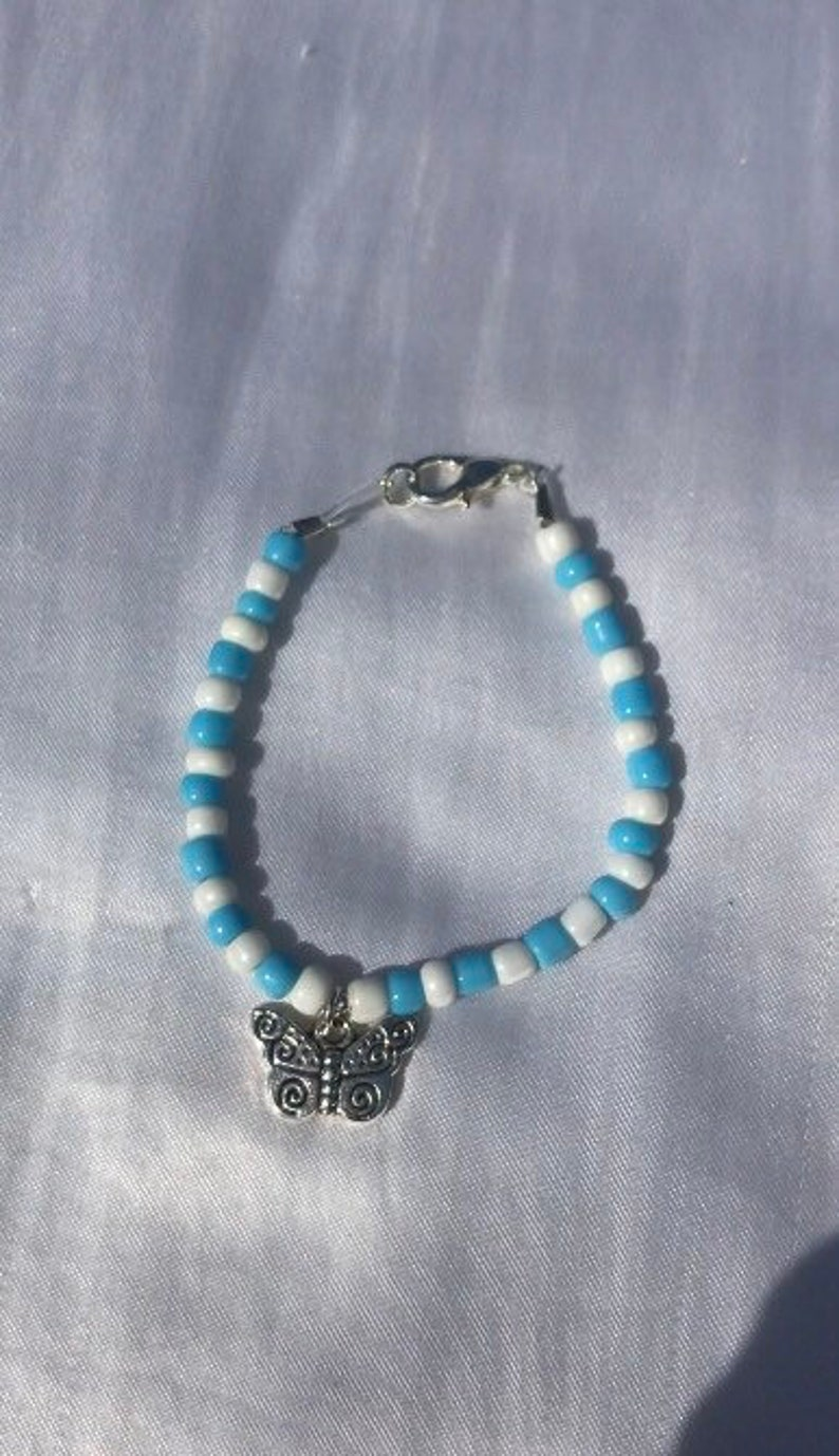 bead bracelet with butterfly charm
