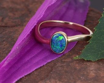 14k Yellow Gold Ring with a Glittering Blue-Green Boulder Opal Doublet