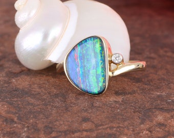 Wonderful Rainbow Opal Ring 14 Karat Gold. Perfect for that special lady!