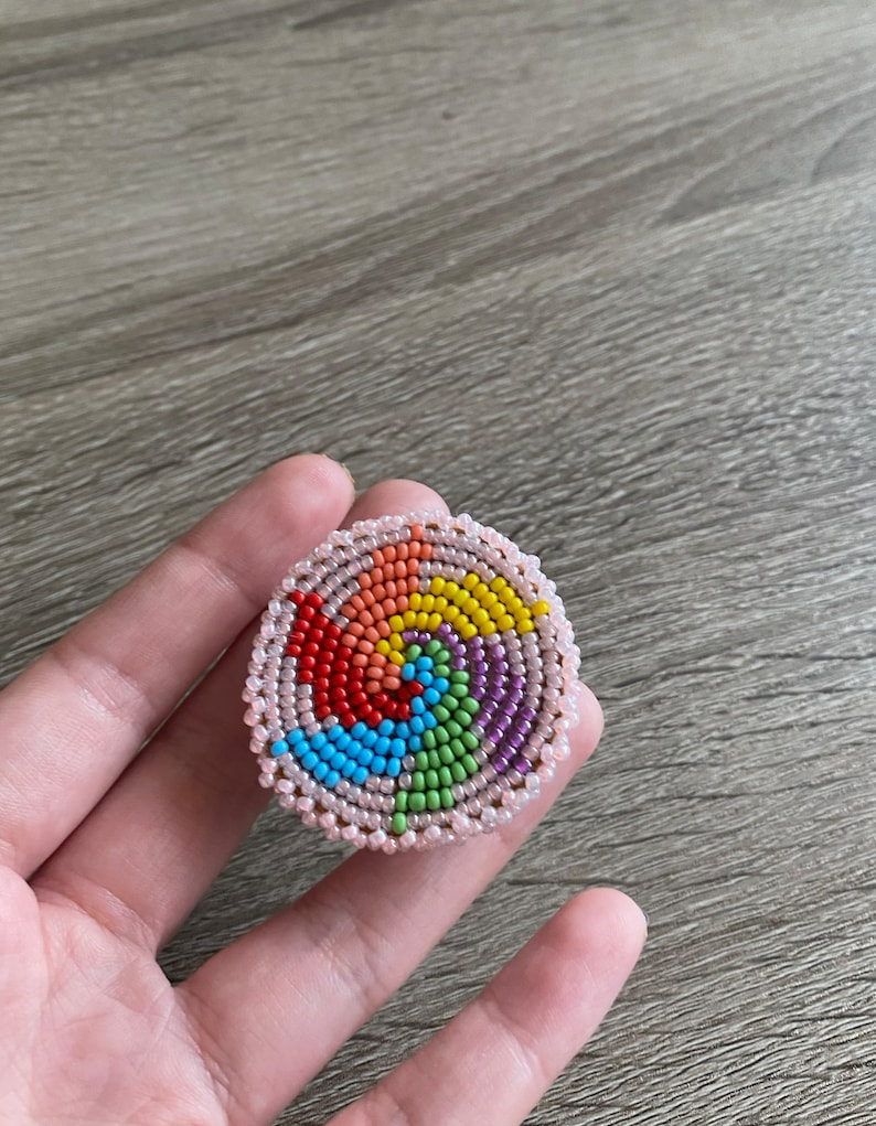 Pink Pinwheel beaded phone grip \u2013 Indigenous flat-stitch beadwork