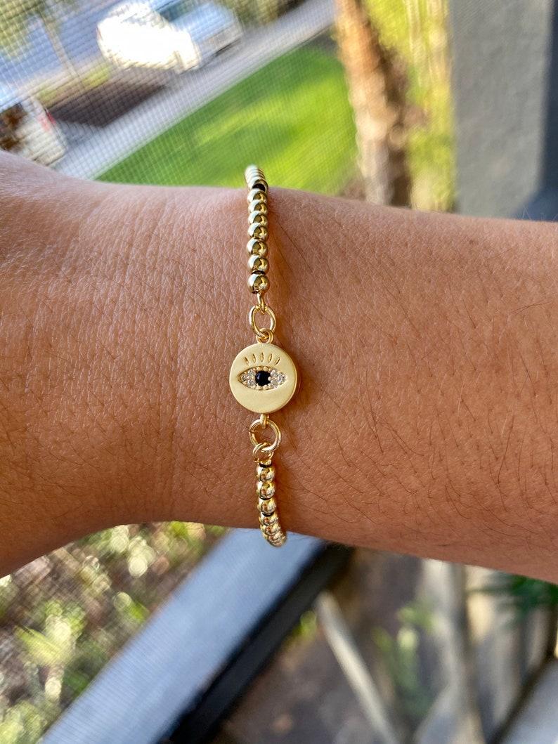 Adjustable golden bracelet with Turkish eye charm!