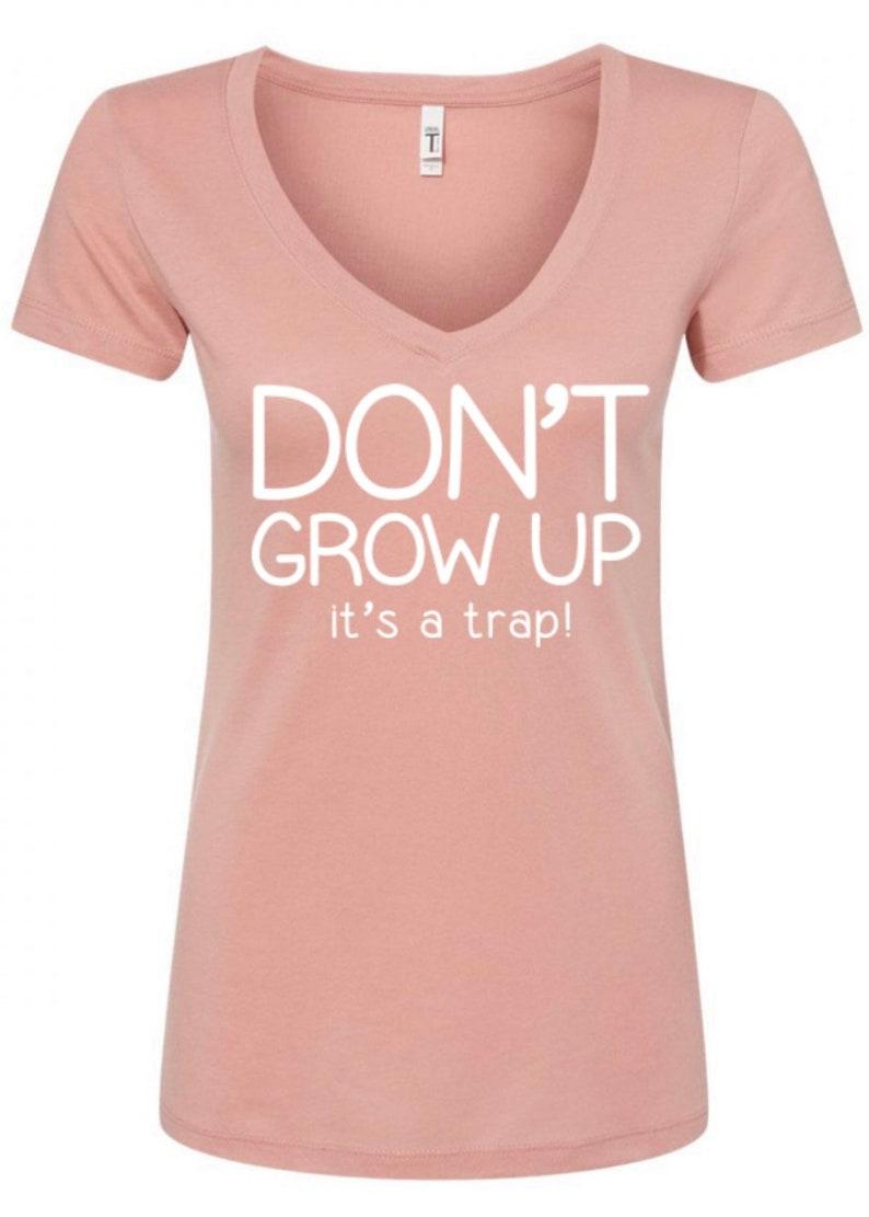 Don\u2019t Grow Up It\u2019s a Trap Graphic Tee on desert pink vneck