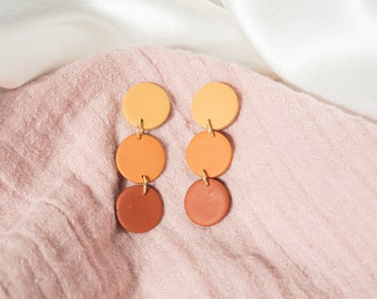 Yellow butterfly and real dried orange lantana flower teardrop resin earrings with gold plated French hooks