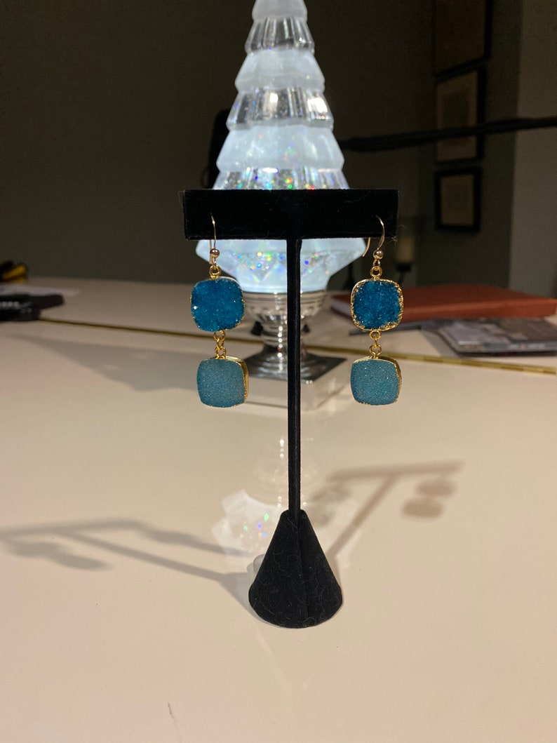 Gold electroplated blue druzy dangle earrings with 14k gold filled chain and hooks.