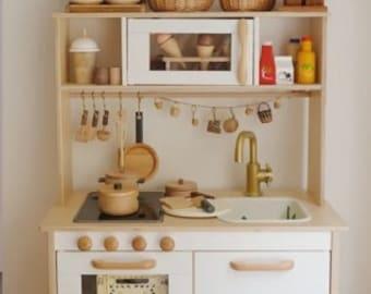 Ikea play kitchen duktig wood handles, play kitchen improvement, ikea kitchen makeover,oven handle, kitchen handles, wooden handles