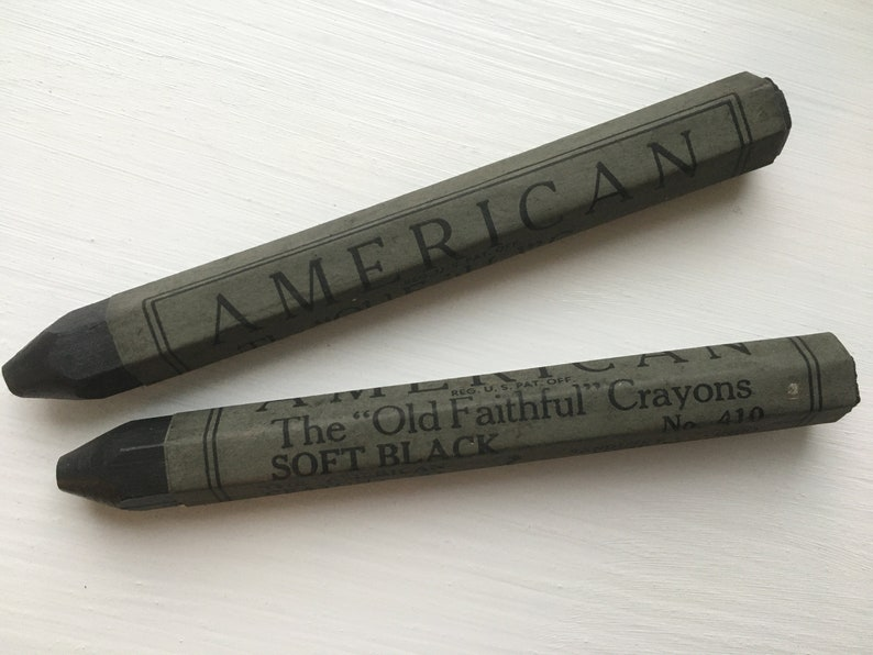 A box of four vintage American Crayons