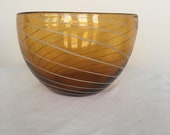 A vintage hand- blown Italian Murano glass amber- coloured bowl with white swerves