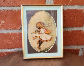 Framed Girl with flower and Petal blowing in the wind Poster Charming Vintage Paper art G. Ranck