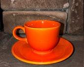 1969- 1973 Mango Red, Ironstone Fiesta tea-cup and saucer set.