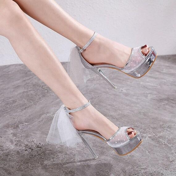 The Sparkling Platinum Bow Sandal