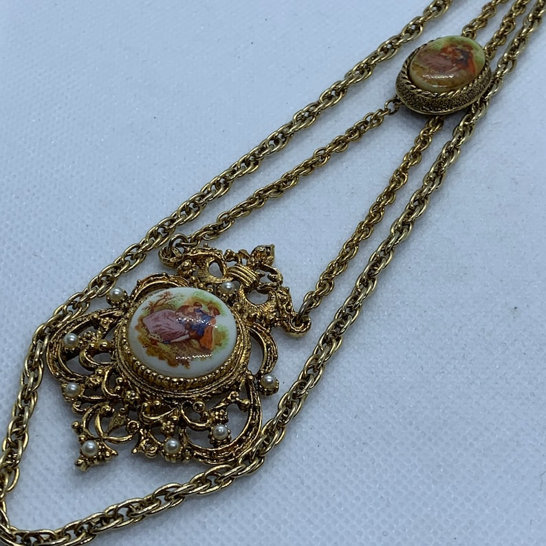 Vintage Two Strand Gold Tone Necklace with One Pendant Which Has A 1800/'s Scene On ChinaPorcelain Longest Strand is 16 inches when hanging