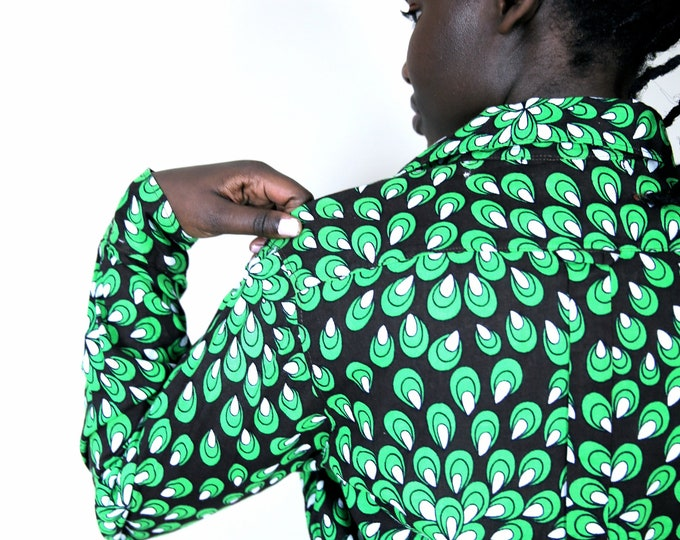 Cotton WAX shirt, S/M size, press closure.