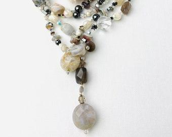 Lasso necklace in agate freshwater breeding pearls,silver,crystal ,hematite, cherry blossom jasper, rock crystal a unique gemstone design