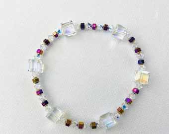 Crystal bracelet with galvanized hematite in rainbow colors on rubber a beautiful gift