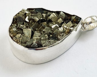 Pendant in silver set pyrite in drop shape