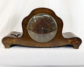 Antique Kohler walnut mantel clock with intarsia. Ornate clock with a mechanical movement
