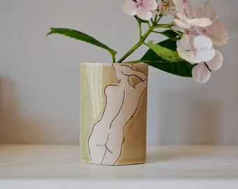 Handmade ceramic vase with figure