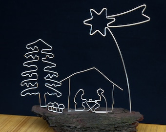 Crib made of silver wire on bark