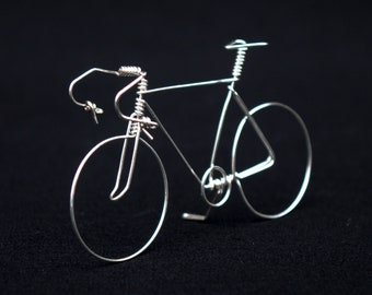 Miniature bicycles made of silver wire
