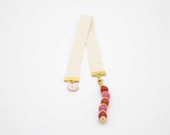 Brand-page jewel with alternating pink red beads and pink letter charm, reader or reader gift idea