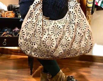 Soft leather bag with double laser processing
