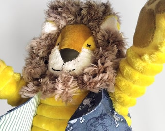 Lion. Soft toy. Animal. Yellow toy. Sir Andry