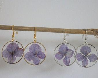 Real purple flower earrings under resin