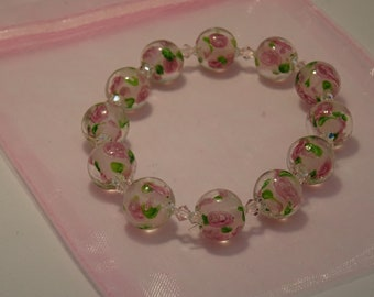 Handmade lampwork bead set of 7 magenta and pink swirly beads