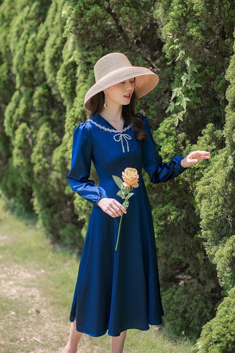 Vintage Style Dresses | Vintage Inspired Dresses Royal Blue Satin Vintage Cottagecore Style Midi Dress with Faux Pearl Bow | MAGGIE $56.94 AT vintagedancer.com
