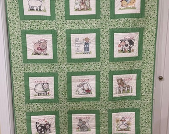 Baby quilt hand embroidered and hand quilted Old McDonald had a farm