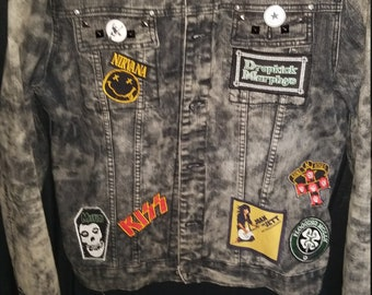 Custom hand sewn patch and studed, acid washed denim jacket