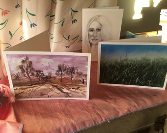 Pack of three blank greeting cards featuring original Polly Sutherland prints Lush Meadow,Lovely Landscape and Beautiful Lady.