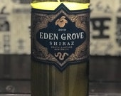 Eden Grove Shiraz 2019 Red Wine Bottle Candle with English Pear and Freesia scented soy wax. Unique wine gift for red wine lovers.