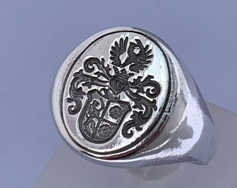 Massive signet ring with a beautiful coat of arms made of 925 silver