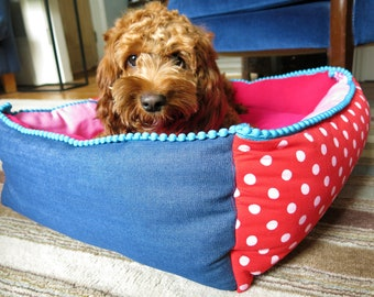 Small square pet bed.