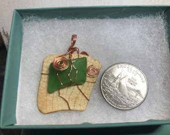 Genuine, hand-made in Rhode Island, copper wire-wrapped, reversable natural sea glass and pottery shard pendant.