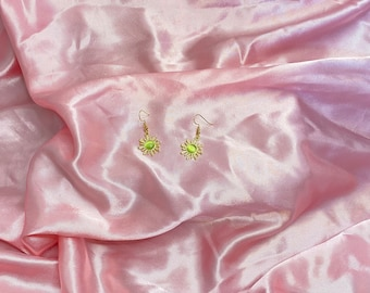 Gold sunshine with green centre earrings