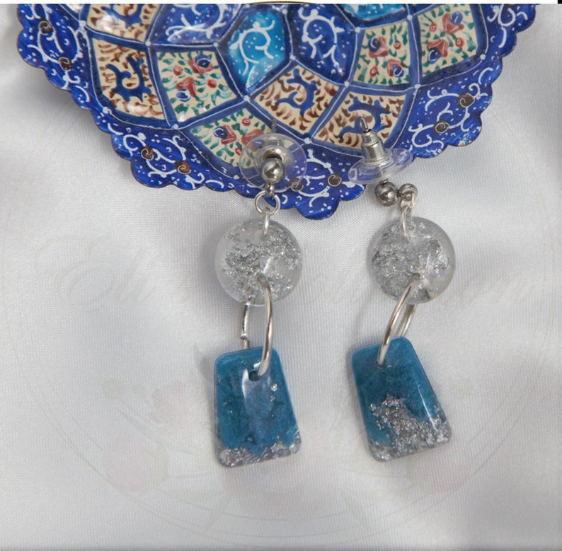 Handmade sky blue resin earrings designed with silver flakes and hypoallergenic silver attachments from Silver Sky collection.