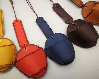 binocle door, leather bezel door around the neck