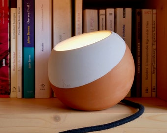 Turn-shaped ceramic lamp, minimalist raw material, warm apoint light each lamp is a unique piece